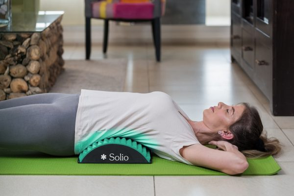 Woman using the Solio Back Stretcher close up