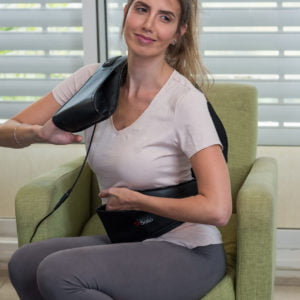 Woman using the Solio T-Massager - it fits your body to best treat any desired area